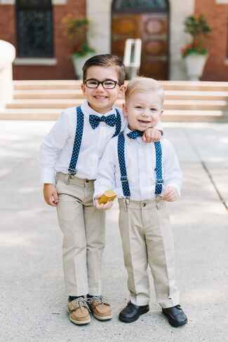 Preppy ring bearers in khaki pants and suspenders