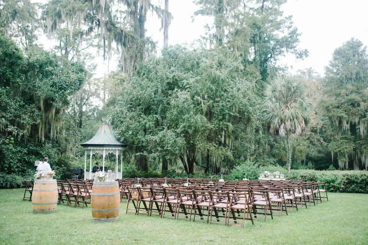 The ceremony was held outdoors, surrounded by lush greenery, shady trees and a quaint gazebo.
