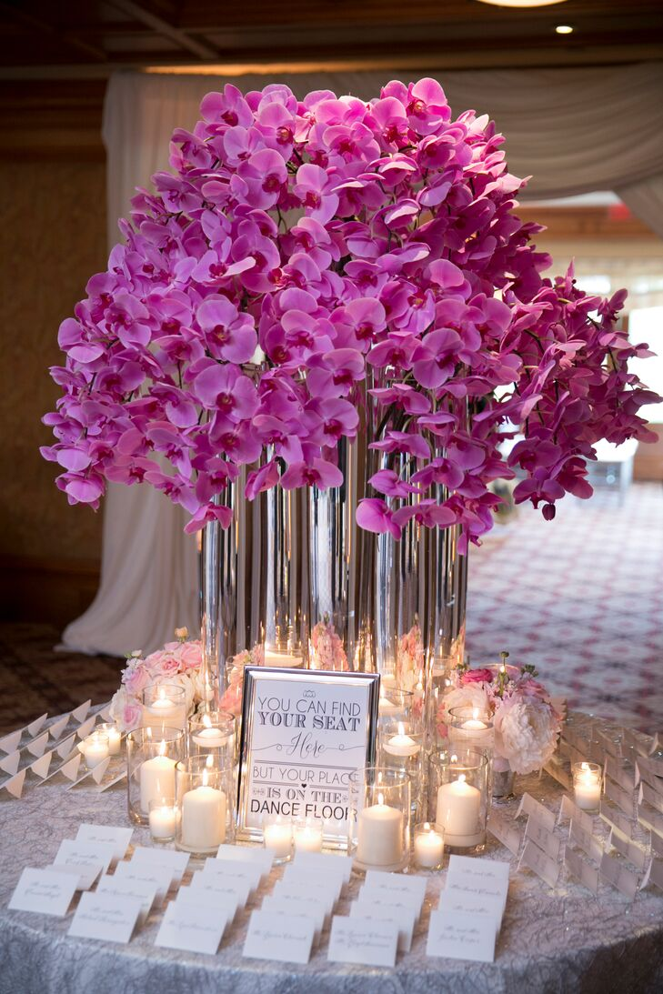 Escort Card Table With Ornate Pink Orchid Flower Arrangement