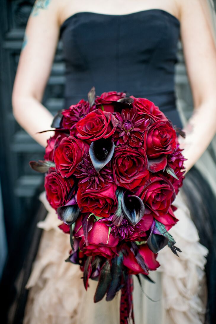 Lindsay's bouquet was made with proteas, black dahlias, black calla lilies and red roses.