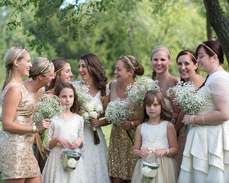 "The bridesmaids wore gold dresses. ""I embrace individuality, and my lovely ladies were all able to pick a dress of their choice that shined as bright as they were comfortable wearing,"" Larrissa says."