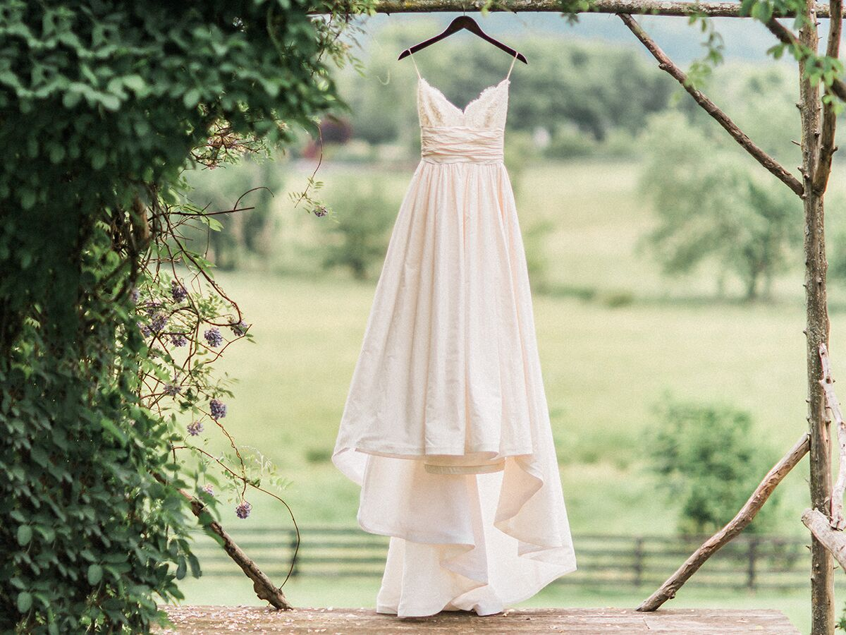 Wedding Dress hanging from alter