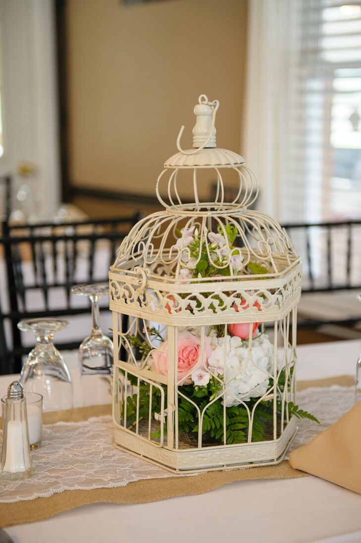 Flowers in vintage birdcage centerpiece