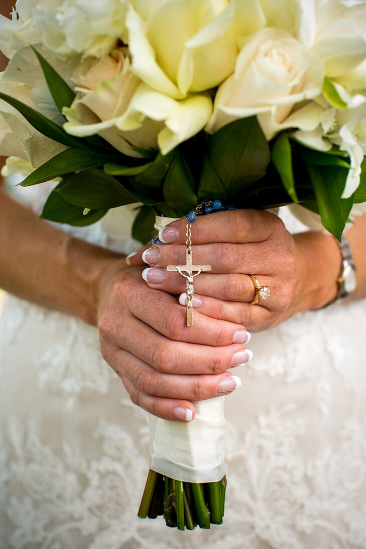 Stephanie and Marc got married in a Catholic ceremony at St. Joseph Catholic Church. It was important to the couple that they stick to tradition, and Stephanie wrapped a blue beaded rosary around the stems of her bouquet. It symbolic of their vows before God, and also her something blue.