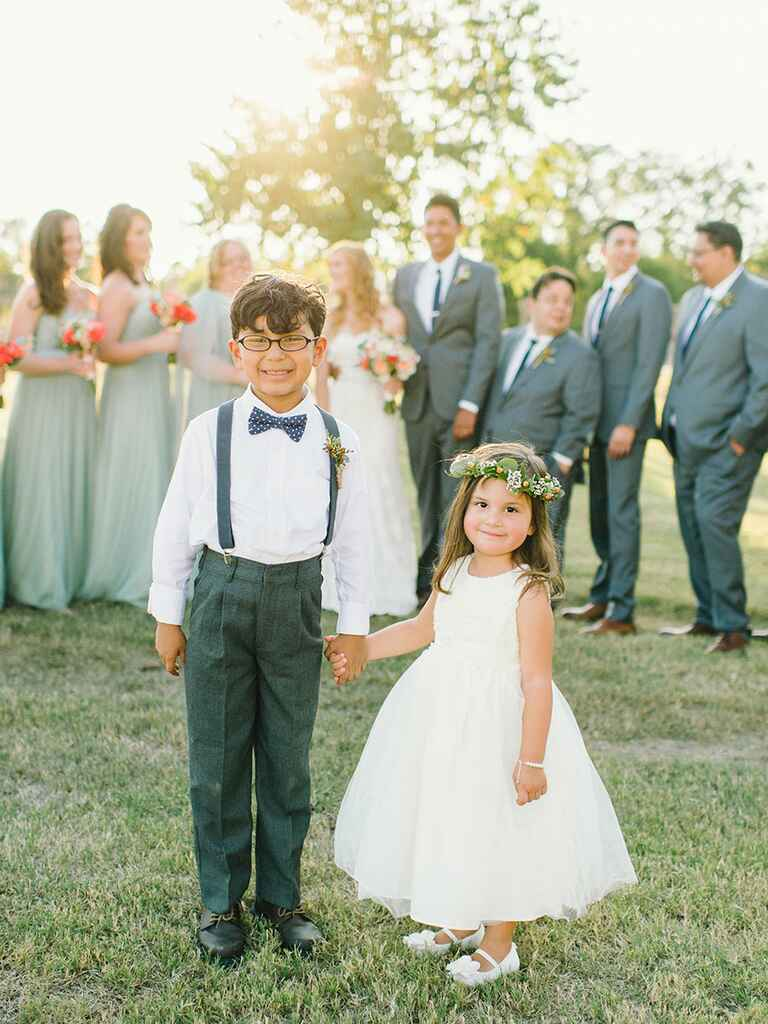 Cute stylish flower girl and ring bearer at wedding